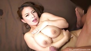 Prexy Japanese MILF Oda Mako strokes a cock more between will not hear of tits