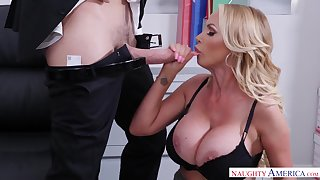 Busty blonde MILF Nikki Benz takes cumshot in the office