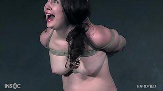 Brunette submissive old bag Brie Haven has her pussy fingered in bondage