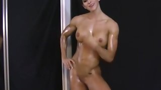 Muscular girl fucks myself with a toy