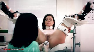 Crazy nurse, Minerva is toying with Valentina Bianco, while they are alone helter-skelter the office