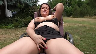 Auntie shows off in the anent yard, masturbating like a slut