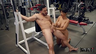 MILF jerks man's dick all over at the gym then gets laid with him