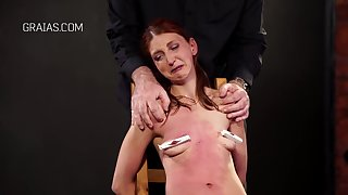Kinky, red haired babe got tied nearby in all directions a chair and forced in all directions drag inflate diverse sex toys