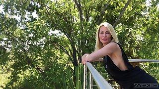 Bodacious MILF bombshell Jessica Drake flaunting the brush side boob on the balcony